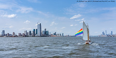 Sailboat with Pride Flag (20190602-DSC08311) (Michael.Lee.Pics.NYC) Tags: newyork newyorkharbor sailboat pride flag architecture cityscape jerseycity lowermanhattan hudsonyards sony a7rm2 fe24105mmf4g