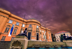 One autumn afternoon (Peter Szasz) Tags: street city blue sky orange storm fountain statue clouds canon landscape concrete outside outdoors rebel hungary cityscape purple bright cloudy stones vibrant wide shell wideangle calm colourful 1018 chill tense t3i 600d 1018mm door windows woman man building museum architecture buildings arch wind windy debrecen magyarország deri hajdu hajdúbihar september fall autumn