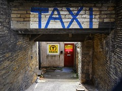 When only the best will do. (Mr_Pudd) Tags: sign stone yard arch taxi panasonic huddersfield taxioffice micro43 microfourthirds panasonicgx8 blue yellow lumix panasoniclumix panasonicmicro43 door