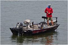 The Masked Fish Troller Strikes Again! (steveartist) Tags: man fisherman lakefishing trolling sportmotorboat trollingmotor outboardengine water weisslake alabama telephoto sonydscwx220 snapseed stevefrenkelphoto pirateflag