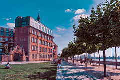 DUESSELDORF, GERMANY - AUGUST 17, 2016: The Rhine promenade passes historic buildings and provides a scenic river view. (axel-d-fischer) Tags: known promenade shopping dusseldorf beer attractive summer warm scenic rhine historicbuilding platanes altbeer visitors old historic germany buildings vintage brewery german town sightseeing drink famous scene urban food duesseldorf summertime planeavenue deutschland august restaurants atmospehre altstadt europe drinks tourists