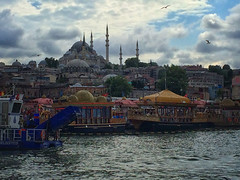 River view of Istanbul, Turkey (` Toshio ') Tags: toshio istanbul turkey river mosque city water turkish riverbank waterfront minarets iphone boat barge seagull bird clouds