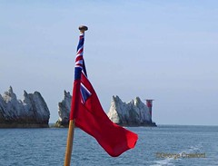 IoW20190430 Needles8 Boat4 (g crawford) Tags: iow iw isleofwight crawford needles theneedles cliffs sea seaside seashore water solent englishchannel panasonic lumix tz60 red redensign lighthouse needleslighthouse needleslight white chalk limestone flag unionflag unionjack yarmouthrose
