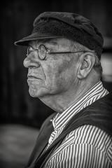 Living History Rolplayer (Dannis van der Heiden) Tags: levendehistorie mannenzaal amersfoort netherlands portrait old people livinghistory blackwhite monochrome blackandwhite glasses cap dof d750 nikond750 tamron70210mmf4 man