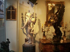 window shopping with glass reflection (miosoleegrant2) Tags: showroom store antiques antiquity artifact heirloom relic bygone monument rarity ruin vestige objetdart window shop neworleans la louisiana french frenchquarter statue
