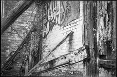 abandoned interior, architectural forms and movements, beams, brick, urban decay, River District, Asheville, NC, Minolta Freedom Dual 60, Eastman Kodak Double-X 200, HC-110 developer, 5.31.19 (steve aimone) Tags: urbandecay architecturalforms architecture interior beams brick graffiti abandoned riverdistrict asheville northcarolina minoltafreedomdual60 eastmankodakdoublex hc110developer 35mm 35mmfilm film monochrome monochromatic blackandwhite compactcamera pointandshoot