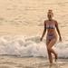 Beautiful woman on the beach in bikini. Looks like Camron Diaz