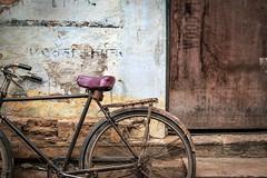 Bicycle Leans (shapeshift) Tags: 50mm 50mm18 d5600 in alley alleys alleyways asia banaras banares benares bicycle davidpham davidphamsf documentary door india nikon nikond5600 patina pealingpaint shapeshift shapeshiftnet southasia street streetphotography travel uttarpradesh varanasi