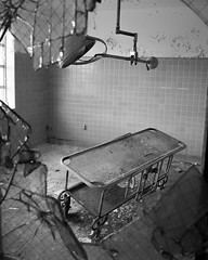 (Industrial Relics Photography) Tags: olympus omd em5 panasonic lumix 14mm 25 abandoned decay building urban exploration hospital gurney surgical light tile walls broken saftey glass