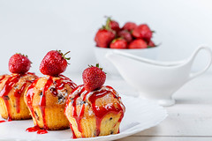 Cupcakes with strawberry sauce and fresh berries on a white plate (wuestenigel) Tags: sugar bake cake dessert sauce sweet breakfast brown background red tasty cupcake delicious baked confectionery food muffin bakery jam cookies strawberry meal nutrition pastry white