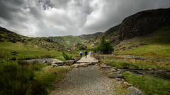 On the right track ... (Einir Wyn Leigh) Tags: park uk summer mountains green nature wales clouds rural landscape outside outdoors track path valley rugged bridge light explore