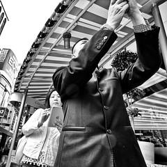 ginza, japan (michaelalvis) Tags: asia bw blackandwhite buildings candid city citylife cellphones cellphone pedestrian fujifilm flickr ginza japan japanese japon monochrome mono nihon nippon peoplestreet portrait people peoplestreets photography streetphotography streetlife street signs travel tokyo urban woman walking x70