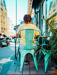 Street - At the Café (François Escriva) Tags: street streetphotography paris france people candid olympus omd photo rue woman colors sidewalk chair green celadon yellow terrace seating area sky girl scooter plant sun vichy shirt