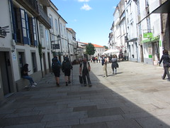 Rua  das  Carretas, Santiago  de  Compostela,  Galicia, Spain. (d.kevan) Tags: ruadascarretas paving pedestrianzone terraces bars restaurants plants trees windows doors spain galicia santiagodecompostela signs tables seats balconies sunumbrellas people decorativedetails