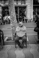 Sitting in La Rambla (gwpics) Tags: catalonia spanish man spain barcelona people mono blackandwhite sitting streetphotography catalonya editorial everydaylife leica lifestyle male men monochrome person socialcomment socialdocumentary society streetscene streetphotos streetpics bw blackwhite street streetlife