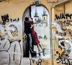 A kissing couple between other graffiti on a wall under the Charles Bridge in Prague (marek&anna) Tags: czechrepublic prague charlesbridge graffiti wall kissing saská lužickésemináře mural flick