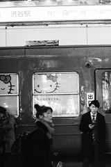 hello kitty train (Claudia Merighi) Tags: blackandwhitephotos blackandwhiteonly blackwhitephotos blackandwhitephotography streetphotography street fotografiadistrada fotografiadecalle bnbwbwbiancoenero claudiamerighi night japan people hellokitty pretoebranco ricohimages