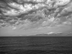 Angry Skies (mswan777) Tags: shore coast water waves horizon outdoor scenic nature cloud weather sky seascape monochrome black white ansel apple iphone iphoneography mobile storm