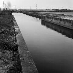 Irrigation channel (odeleapple) Tags: zenza bronica s2 nikkorp 75mm neopan100acros film monochrome analog bw irrigation channel paddy field