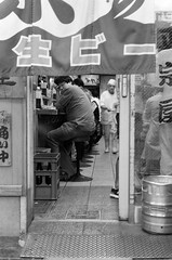 Dizziness (Dekhana Photo) Tags: dekhanaphoto andregenel osaka japan japon kansai analog film pellicule people ilford delta400 minoltax700 blackwhite noiretblanc filmphotography streetphotography shinimamiya sakaisuji bar drunk dizziness montrealbasedphotographer
