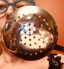 View through the écumoire (ruthlesscrab) Tags: hole skimmer écumoire utensil self werehere wah hereios weird