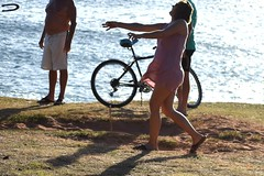 Horseshoes (thomasgorman1) Tags: game horseshoes woman people recreation competition candid streetphotos nikon sea beach resort