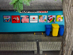 Elephant Juice (Steve Taylor (Photography)) Tags: elephantjuice bath surfboard skeleton bikini brucelee elephant bigsisteriswatchingyou drink straw ibelieveinme superhero wheeliebins dustbins bins bench seat art streetart blue yellow white red green colourful lady woman man tree leaves bark trunk uk gb england greatbritain unitedkingdom london perspective
