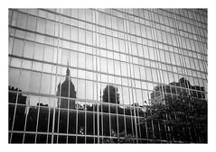FILM - Reflections of empire (fishyfish_arcade) Tags: 35mm analogphotography bw blackwhite blackandwhite canonsureshotz135 filmphotography filmisnotdead hp5 istillshootfilm monochrome newyork analogcamera compact film ilford mono empirestatebuilding reflections