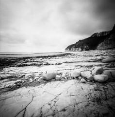 Danes Dyke Beach (Richie Rue) Tags: beach seaside coast rocks cliffs flamborough yorkshire northern landscape intimatelandscape mediumformat squareformat 6x6 120 rollfilm ilfordpanf50 rodinal folm analogue ishootfilm istillshootfilm filmsnotdead outdoors monochrome blackandwhite pinhole lensless