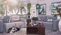 Furnishing the beach house (Rose Sternberg) Tags: second life deco decor home garden interior landscape lorelei set sways for tlc event the liaison collaborative separately sofá buou lamp candle rug crate side table coffee bee designs sunnt coast gacha painting house hive areca palm plant dust bunny hanging cheese ivy planter double rare summer swing dwarf fruit tree tres green apple red clementine