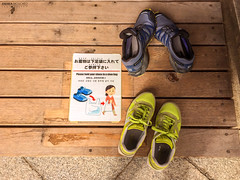 Travel Buddies of Japan (Andrea Moscato) Tags: andreamoscato giappone japan nippon nihon 日本 sollevante vivid light shadow ombre japanese giapponese ombra attraction luce art artist wood floor sign shoes blue yellow