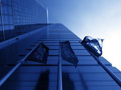 flags (Darek Drapala) Tags: flag blue high sky building architecture city urban civilization europe panasonic poland polska panasonicg5 lumix light warsaw warszawa window