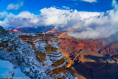Snow Falls Over the Grand Canyon as the Sun Sets (LNY_Photography) Tags: arizona clouds grandcanyon grandcanyonnationalpark grandcanyonsouthrim matherpoint sandstone trees usa blue canyon eroded landscape photography rocks scenicnature shape snowwinter unitedstatesofamerica