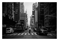 FILM - Another view of 7th Avenue (fishyfish_arcade) Tags: 35mm analogphotography bw blackwhite blackandwhite canonsureshotz135 filmphotography filmisnotdead hp5 istillshootfilm monochrome newyork analogcamera compact film ilford mono 7thavenue streetphotography bicycle