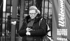 Call Me (byronv2) Tags: edinburgh edimbourg scotland saintandrewssquare peoplewatching candid street woman phone mobilephone cellphone blackandwhite blackwhite bw monochrome