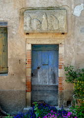 Door and bas relief (Donard850) Tags: france bas relief flowers bruniquel door blue medieval village 1855f284 fujixt20 wall