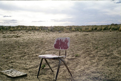 Chair (carlonsae) Tags: chair red fade field dirt beans native konica auto s3
