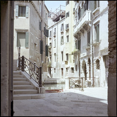 Venezia #6 (BG Sixtyniner) Tags: venice italia venezia quiet peaceful heighborhood secluded midday lunchhour summer silence buildings residential architecture old historic canal sea facade film analog mediumformat roll 120 square 6x6 color c41 kodak portra160 hasselblad500cm carlzeiss planar f28 80mm vuescan canoscan9000f