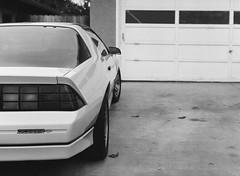 San Jose, California (bior) Tags: pentax645nii 6x45cm pentax645 ilfordfilm hp5plus hp5 ilfordhp5plus 75mm sanjose california fence suburbs residential house driveway car cover chevy chevrolet camaro z28