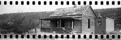 (No Stone Unturned Photography) Tags: black white monochrome kodak folding expired ilford delta 100 35mm film sprocket holes jiffy camera art deco 1933 six16 616 panoramic abandoned house home