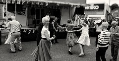 Brighouse 1940s Weekend. Dancin' In The Street. June 2019 (Simon W. Photography) Tags: ladies girls england people blackandwhite bw woman history girl monochrome face fashion festival sepia lady female vintage person blackwhite women war couple feminine candid sony wwi wwii crowd style monotone historic retro nostalgia 1940s mature ww2 nostalgic females grayscale hairstyle groupshot lightandshadow bnw westyorkshire armedforces greyscale livinghistory brighouse vintagefestival nocolor nocolour calderdale 1940sweekend wartimeevent victoryrolls 1940svintage sonyuk brighouse1940sweekend sonyrx10iv sonyrx10m4 wartimeevent2019 sonydscrx10m4
