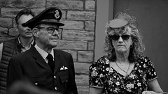 Brighouse 1940s Weekend. Proudly Together. June 2019 (Simon W. Photography) Tags: brighouse1940sweekend brighouse 1940sweekend 1940s calderdale westyorkshire england wartimeevent wartimeevent2019 vintagefestival victoryrolls hairstyle armedforces nostalgic nostalgia fashion vintage festival retro ww2 1940svintage livinghistory history historic war wwi wwii people person mature groupshot crowd face women couple girls girl woman lady ladies female feminine females candid style sonyrx10iv sonyrx10m4 sonyuk sony blackandwhite blackwhite monochrome monotone greyscale grayscale bw bnw nocolour nocolor lightandshadow sepia sonydscrx10m4