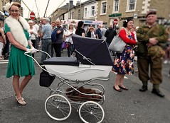 Brighouse 1940s Weekend. Proud Parent. June 2019 (Simon W. Photography) Tags: brighouse1940sweekend brighouse 1940sweekend 1940s calderdale westyorkshire england wartimeevent wartimeevent2019 vintagefestival victoryrolls hairstyle armedforces nostalgic nostalgia fashion vintage festival retro ww2 1940svintage livinghistory history historic war wwi wwii people person mature groupshot crowd face women couple girls girl woman lady ladies female feminine females candid style sonyrx10iv sonyrx10m4 sonyuk sony sonydscrx10m4