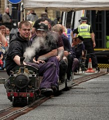 Brighouse 1940s Weekend. Model Train. June 2019 (Simon W. Photography) Tags: train trainstation ticketoffice modeltrain passenger passengers steamtrain lner gwr nrm brighouse1940sweekend brighouse 1940sweekend 1940s calderdale westyorkshire england wartimeevent wartimeevent2019 vintagefestival victoryrolls hairstyle armedforces nostalgic nostalgia fashion vintage festival retro ww2 1940svintage livinghistory history historic war wwi wwii sit sat sitting seated seat reclining relax relaxing