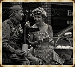 Brighouse 1940s Weekend. Soldier n Wife. June 2019 (Simon W. Photography) Tags: ladies girls england people blackandwhite bw woman history girl monochrome face fashion festival sepia lady female vintage person blackwhite women war couple feminine candid sony wwi wwii crowd style monotone historic retro nostalgia 1940s mature ww2 nostalgic females grayscale hairstyle groupshot lightandshadow bnw westyorkshire armedforces greyscale livinghistory brighouse vintagefestival nocolor nocolour calderdale 1940sweekend wartimeevent victoryrolls 1940svintage sonyuk brighouse1940sweekend sonyrx10iv sonyrx10m4 wartimeevent2019 sonydscrx10m4 relax sitting seat relaxing sit sat reclining seated