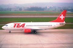 TEA Switzerland Boeing 737-300; HB-IIE@ZRH;09.03.1997 (Aero Icarus) Tags: zrh zürichkloten zürichflughafen zurichairport lszh plane avion aircraft flugzeug negativescan