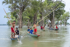 Steung Treng - Exploring the Mekong River with the Young Warriors Of Kratie (Mio Cade) Tags: steungtreng cambodia mekong river tree mangrove boy kid children boat fisherman fish lao asia travel