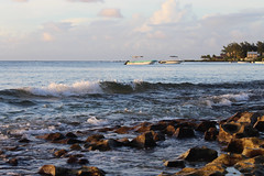 The Sea (Rckr88) Tags: ocean sea water rock rocks waves wave pointe thesea mauritius aux the biches pointeauxbiches travel travelling beach nature boats outdoors coast boat sand coastal coastline naturalworld beachsand