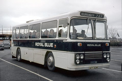 Western National Omnibus Company . 1321 NTT321M . Exeter Coach Station , Devon . December-1973 . (AndrewHA's) Tags: bus coach westernnational royal blue bristol lh marshall 1321 ntt321m national travel route 727 bournemouth narrow rain