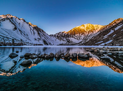 """Sunrise in the Sierras""  Convict Lake (Cathy Lorraine) Tags: sunrise dawn mountains sierras lake blue gold reflections snow ice spring california convictlake"